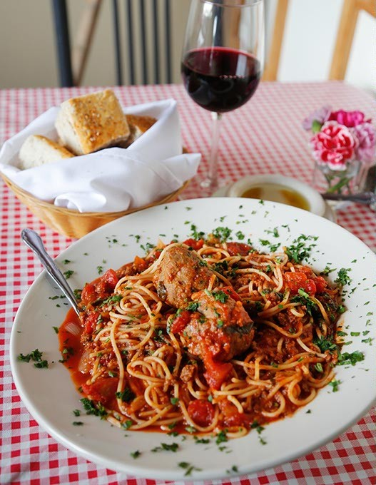 Spaghetti with meat sauce and meat balls at Vito's Ristorante in Oklahoma City, Thursday, July 30, 2015. - GARETT FISBECK