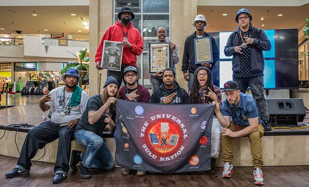 Members of the Oklahoma City chapter of the Universal Zulu Nation pose for a picture with a proclomation from the city designating November as Hip-Hop History Month. - MICHAEL GENTRY / PROVIDED