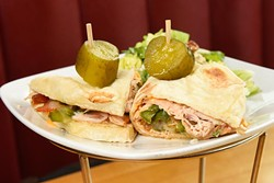 Classic Turkey Piadine sandwich at Upper Crust Pizza, Friday, March 18, 2016. - GARETT FISBECK