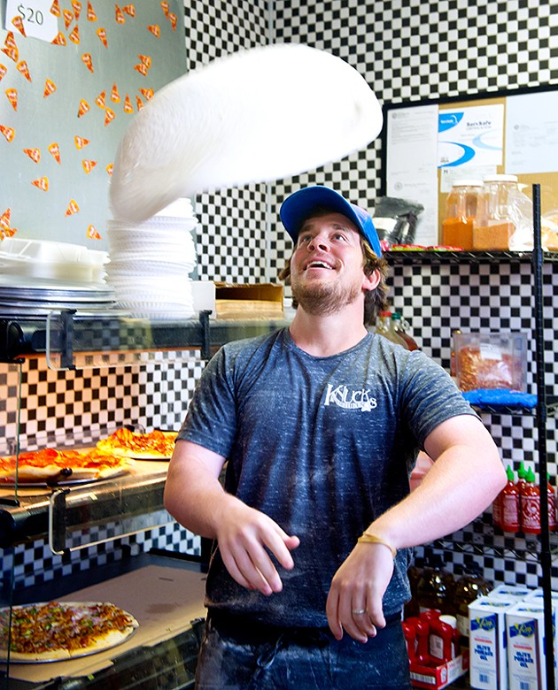 Owner, Drew Mains tosses pizza dough at Knuck's Wheeelhouse (Shannon Cornman)