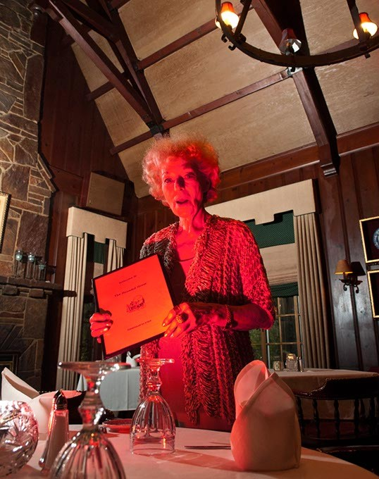 Owner Marian Thibault in the large dining room at the Haunted House Restaurant.  mh