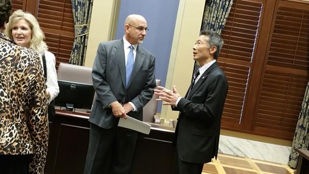OKC Superintendent Rob Neu chatted with Sen. Ervin Yen following a breakfast hosted by OKC and Tulsa schools. - BEN FELDER