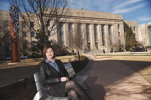 Aubrey Hamontree, Head of theCity of Oklahoma City Planning Department, sits on one of the new park bencheson the east side of City Hall, 1-28-16. - MARK HANCOCK