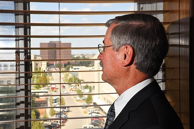 Judge Ray Elliott looks out of his office window in the Oklahoma County Courthouse towards the Oklahoma Coutny Jail, 9-16-15. - MARK HANCOCK