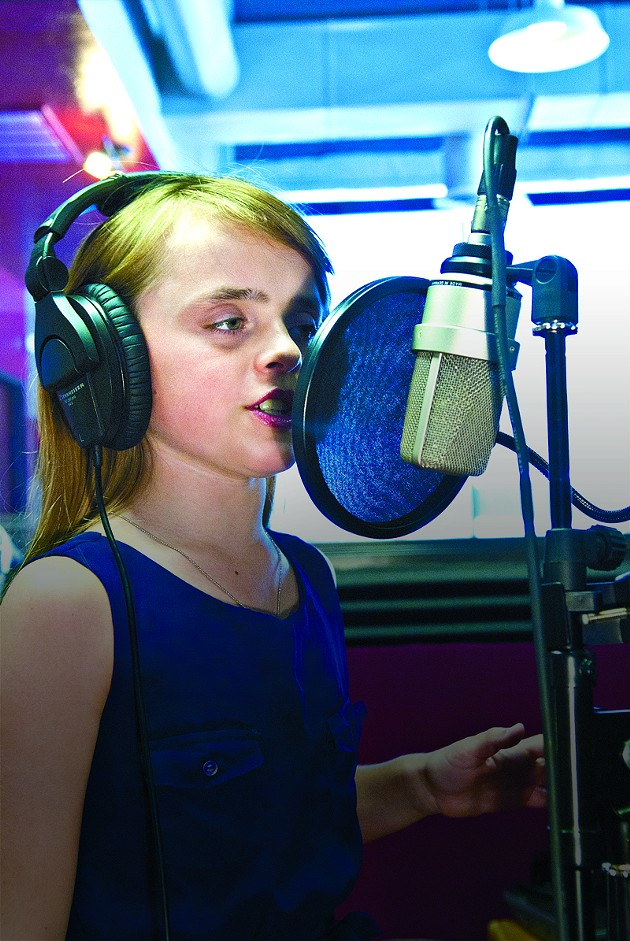 Olivia Kay demonstrates her vocal recording technique at Next Star Studio on Auto Alley in OKC.  mh