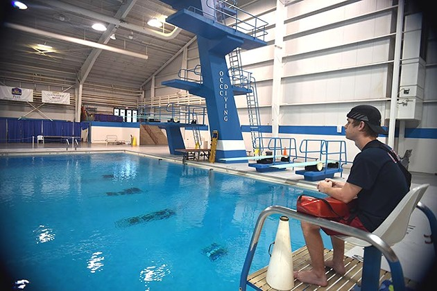 Colin Waldrop will be out of his lifeguard job when the OCCC Aquatic Center closes at the end of summer, shown in the seat in front of the OCCC Diving pool.  mh
