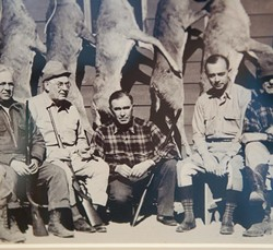 Detail from a photo hanging in Kent Frates' office, center is Charles Urschel, Machine Gun Kelly's kidnap victim, with Frates' Dad, C.L. Frates at right, and and U.S District Judge Edgar Vaught, the trial judge for the Machine Gun Kelly case, at left.  mh