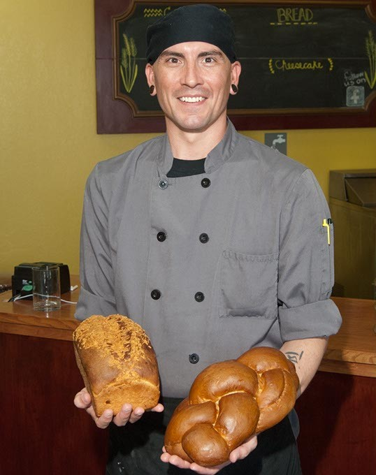 Baker John Collins with 4 braid challah and Jalapeno cheddar breads. (Mark Hancock)