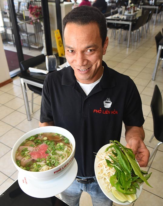 Phong Nguyen with an extra large #P1 combo at Pho Lien Hoa.  mh