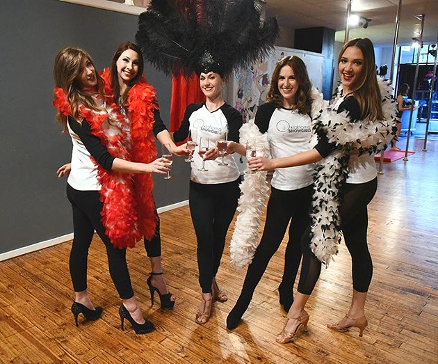 Lynn Crowe, owner, center, surrounded by her girls with feather fans, boas and champaign at Teaze Dance, on Broadway in Oklahoma City, 1-26-16. - MARK HANCOCK