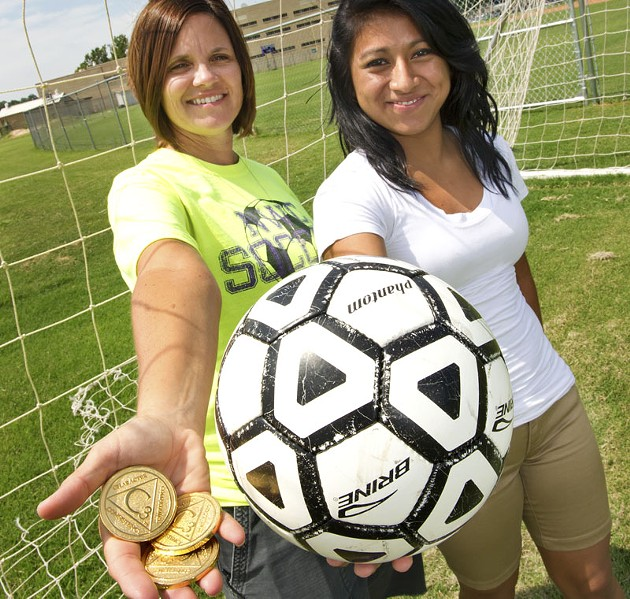 Left, NW Classen Coach Cindy George with The Elevate Character gold medal award and student athlete Yasmi Lopez 16, a sophmore. Yasmi (pronounced Jasmi) won the award last year in soccer for Courage. Photo/Shannon Cornman - SHANNON CORNMAN