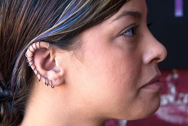 A ring of 16 gage continuous hoops worn by Ashley Primm at Hall of Tattoos on Main Street in Norman.  mh