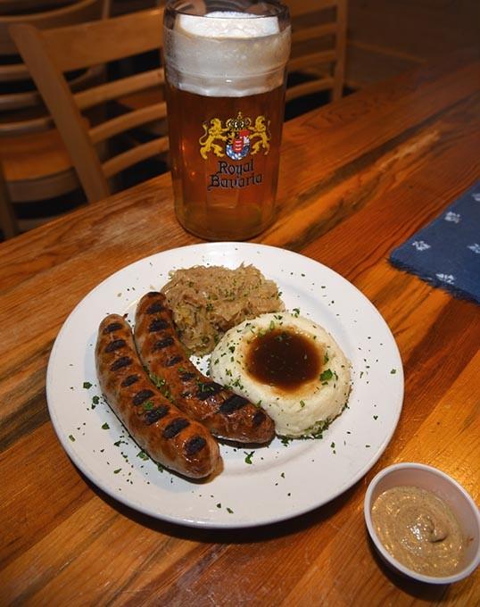 Stck.grobe Bratwurste mit Sauerkraut und Kartoffelbrei, with one of their house brews, at Royal Bavaria, 3401 S. Sooner Road in Moore, Oklahoma, 12-15-15. - MARK HANCOCK