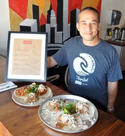 Ed Koch poses in his restaurant, Union Tacos in downtown Guthrie, Okla. Lauren Hamilton