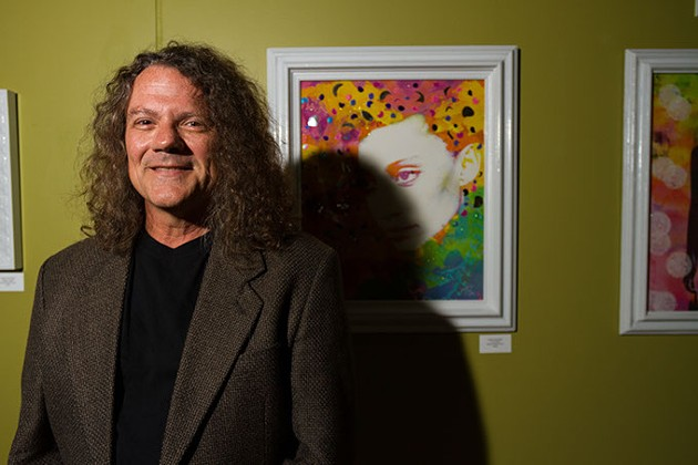 owner of gallery Verbode Steven Kovash stands in front of an artist work he's curating at 415 N Broadway in Oklahoma City, Oklahoma, monday, june 22, 2015 - KEATON DRAPER