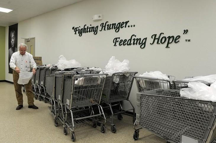 John Gorrell, a volunteer, prepares shopping carts at Skyline Urban Ministry in Oklahoma City, Monday, Nov. 24, 2014. - GARETT FISBECK