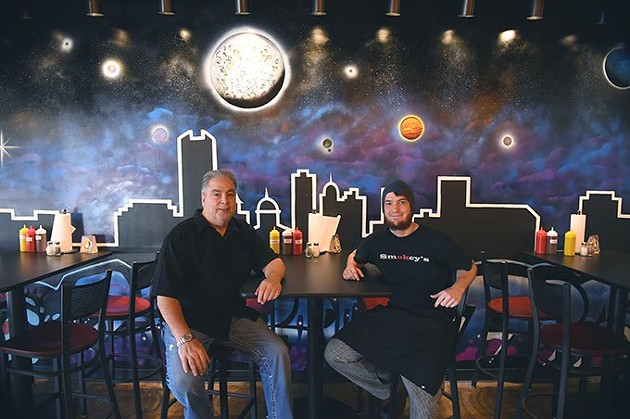 From left, owner, Jerry Coles and head chef, Nick Carson, strike a pose in front of a new mural in their newly reopened, Smokies BBQ, on N. Portland Avenue in OKC, 11-17-15. - MARK HANCOCK