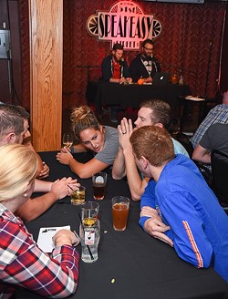 A group of  friends play during The Lost Ogle's Team Trivia Night at the 51st Street Speakeasy, 10-20-15. - MARK HANCOCK