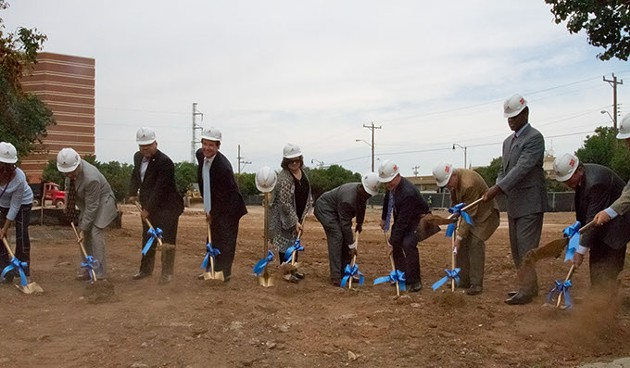 Officals with shovels breaking ground on the beginning construction of the new municipal courts building in Oklahoma City, Monday, August 3, 2015. - KEATON DRAPER