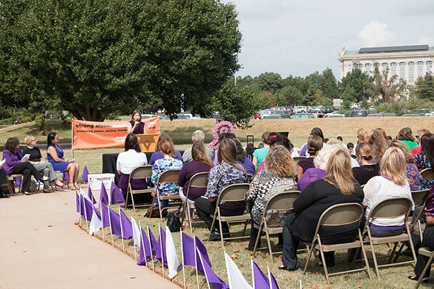 WOH3 - Sherry Knuth of Verizon Oklahoma addressing the crowd at a Wreath of Hope Ceremony honoring victims of domestic violence last month.