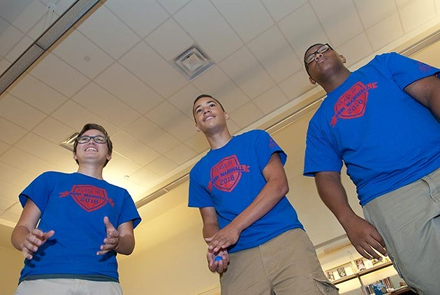 """Left, Mykaela Salcido, Malachi Mills, and Darian Featherstone participate in """"team juggle"""" exercise as part of the John Marshall High School Links program.  mh"""