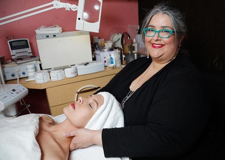 Alex Mendez poses for a photo with Sarah Taylor at the Makeup Bar in Oklahoma City, Friday, May 15, 2015. - GARETT FISBECK