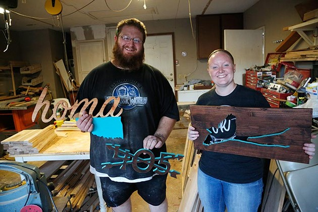 Michael and Hali Lawrence show some of their products at their shop in Bethany, Wednesday, Oct. 14, 2015. - GARETT FISBECK