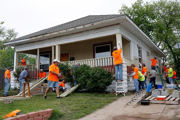 Volunteers work during Rebuilding Day in the Classen Ten Penn neighborhood in Oklahoma City, Saturday, April 18, 2015. - GARETT FISBECK