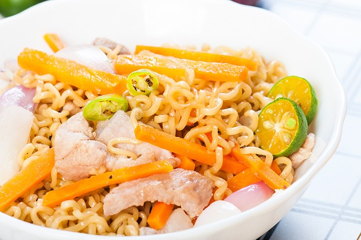 pancit canton for merienda or snacks popularize in the Philippines - BIGSTOCK