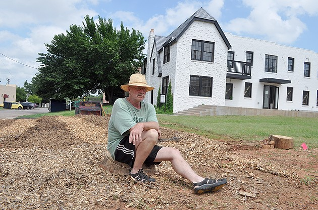 Ron Ferrell poses in front of the new 612 school, which will host artist from around the country to teach children and the community about nutrition and food, on Friday, June 27, 2014 in the Paseo District of Oklahoma City, Okla. - LAUREN HAMILTON