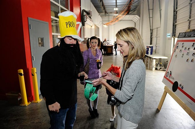 Chris Heck and his wife, Franny, donate to the Food For All truck as Adrian Young runs a fundraiser during COOP Ale Works Tap Room Halloween Party, Saturday, Oct. 24, 2015. - GARETT FISBECK