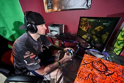 "Johnny ""Icychiller"" Weaver plays Halo at his home in Wellston. (Photo by Garett Fisbeck) (Garett Fisbeck)"
