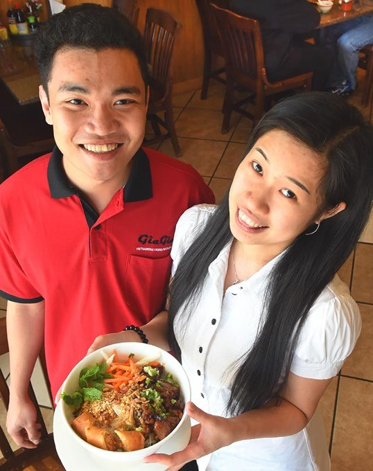 Left, Cuu Le and Thuy Tran with Bun thit nuong cha gio, at Gia Gia Vietnamese Restaurant.  mh