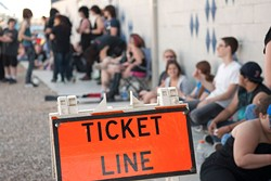 Young people with tickets for the sold out Marilyn Manson show wait in a line outside the Diamond Ballroom to be admitted, 5-15-12.  mh