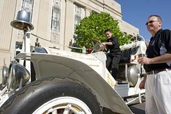 John Vasquez and Raymond Melton admire a 1910 Oklahoma City fire engine parked in front of City Hall for the city's 25th birthday celebration. Photo/Shannon Cornman - SHANNON CORNMAN