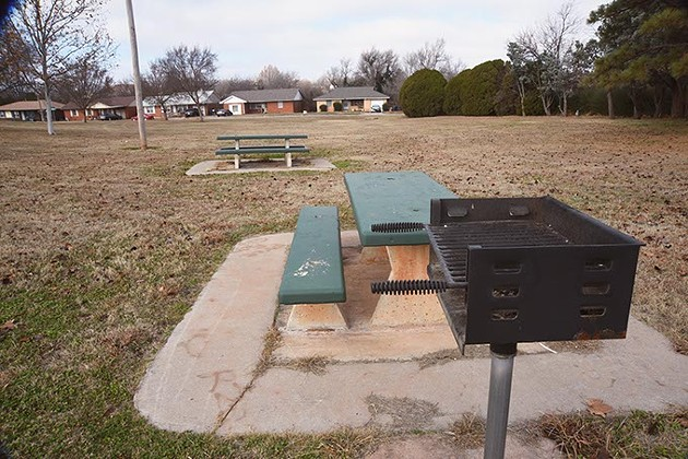 Grill and picknic tables with neighborhood beyond at McNabb Park in northeast OKC.  mh
