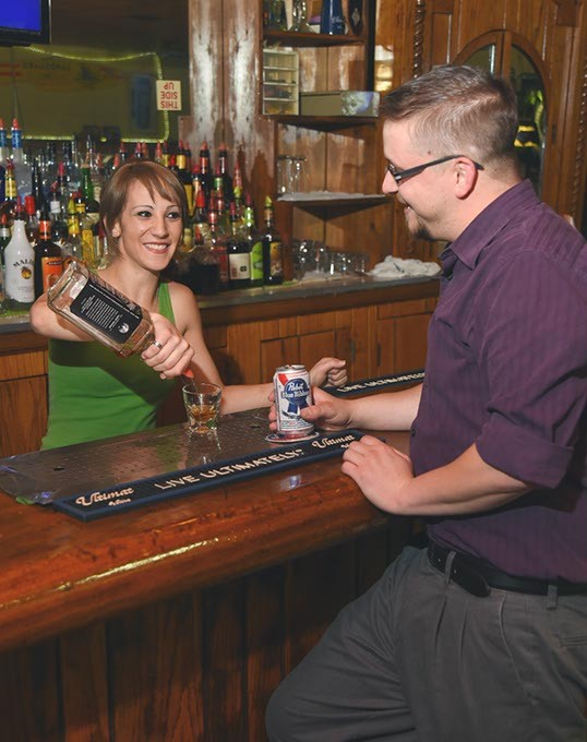 Dandice Porter pours Drew Renshaw a drink at Little Kicks Halfway Inn.  mh