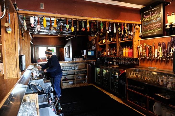 Jeff Anshutz works the bar at the 51st Street Speakeasy in Oklahoma City, Tuesday, Jan. 27, 2015. - GARETT FISBECK