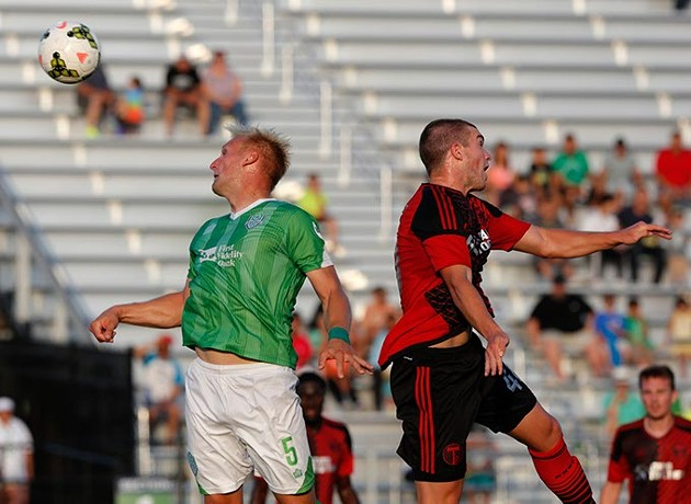 Oklahoma City's Gareth Evans (5) goes against Portland's Tim Payne (40) during a game between Energy FC and T2 at Taft Stadium in Oklahoma City, Friday, June 5, 2015. - GARETT FISBECK