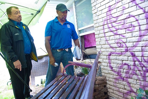 From left, Charles Locke, superintendant, and Ron Pollard, municipal code officer, for the City of OKC, chick out a back porch where vagrants have been hanging out at a vacant property at 1324 SW 43rd during an inspection, 6-19-14.  mh
