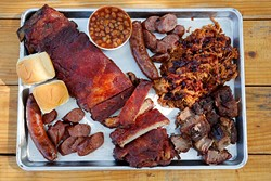 Ribs, Burnt ends, Smoked hot link and sausage, Pulled pork, and Apple pie baked beans at Butcher BBQ in Wellston, Friday, Aug. 7, 2015. - GARETT FISBECK