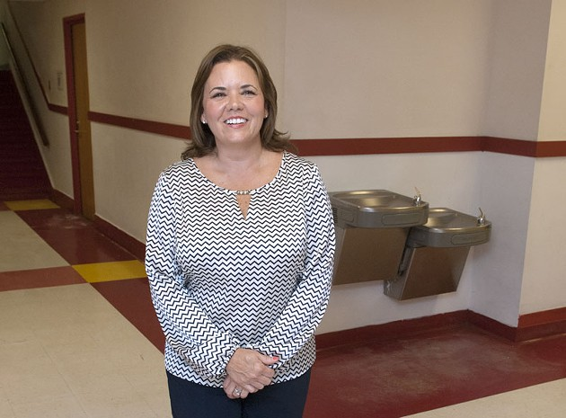 Kelley Pearson a volunteer, photographed in the hallway at Edgemere Elementary School.  mh