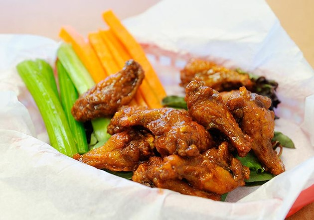 Hot wings in honey love sauce at Wing Supreme in Oklahoma City, Thursday, Jan. 28, 2016. - GARETT FISBECK
