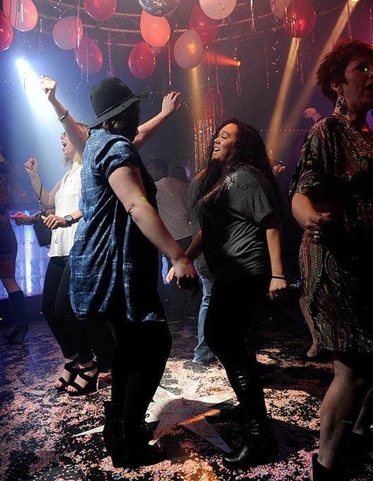 People dance at Groovys in Oklahoma City, Saturday, Feb. 14, 2015. - GARETT FISBECK