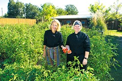 Chefs Kamala Gamble and Barbara Mock use fresh produce from Guilford Garden's fall crop. (Shannon Cornman)