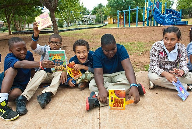 Putnam Heights Elementary students show the books they picked out inside the Rolling Thunder Book Bus, 9-11-2014.  mh