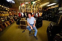 Guitar instructor Macky Climer at Rawson Music, Wednesday, March 30, 2015. - GARETT FISBECK