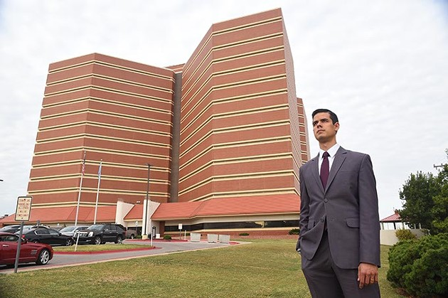 A graduate student in Harvard University's public policy program, Adam Luck, stands next to the Oklahoma County Jail, 10-8-15. - MARK HANCOCK