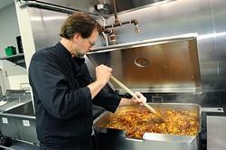 Chef Kurt Fleischfresser preps lunch at WestTown day shelter in Oklahoma City, Tuesday, March 24, 2014. - GARETT FISBECK