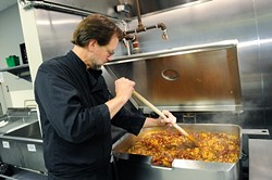 Chef Kurt Fleischfresser preps lunch at WestTown day shelter in Oklahoma City, Tuesday, March 24, 2014. - GARETT FISBECK